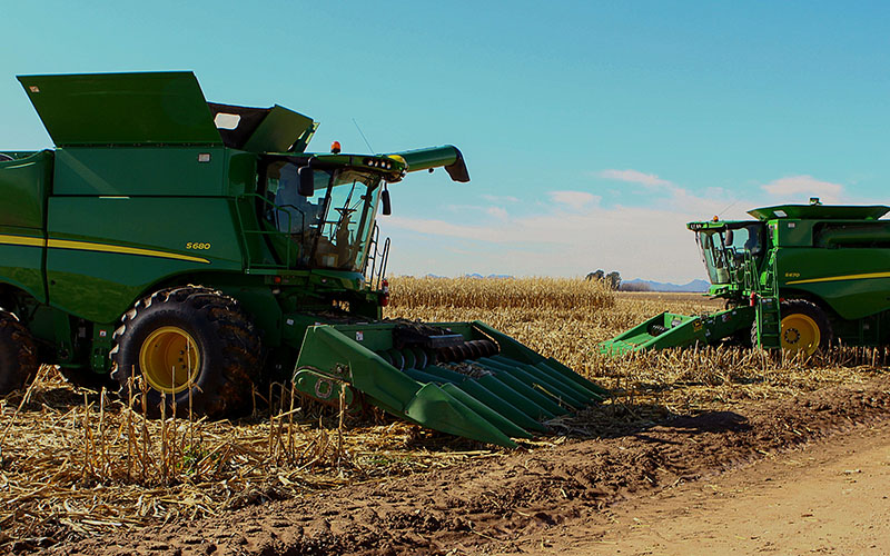 Two corn headers sit in a half-harvested field in Marana, south of Interstate-10. (Photo by Taryn Martin/Cronkite News)