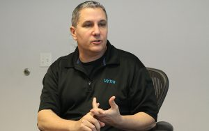 Scott Dilullo, federal law enforcement business development manager at VirTra, talks about the advantage of using multiple screens. (Photo by Megan Bridgeman/Cronkite News)