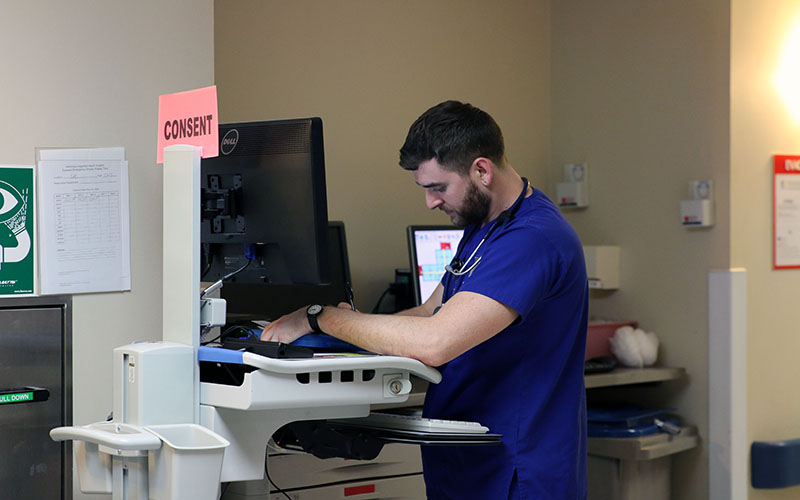 Christopher Saunders, a nursing senior from Chamberain College, is getting in-field experience at Maricopa Integrated Health Services. (Photo by Courtney Kock/Cronkite News)