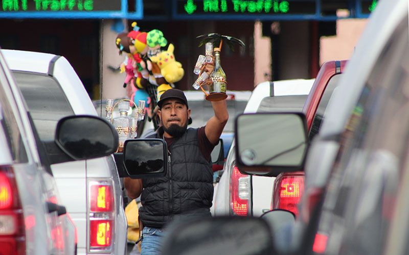 Street vendor Eduardo Rabago sells glass souvenirs at the border crossing line in Nogales, Sonora Mexico (Photo by Charlene Santiago/Cronkite News)
