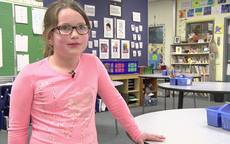 McKenzie Brown, a second-grader at Manzanita ElementarySchool in Tucson, likes using a standup desk. She says it keeps her from falling asleep in class. (Photo by Ivory Riner/Cronkite News).