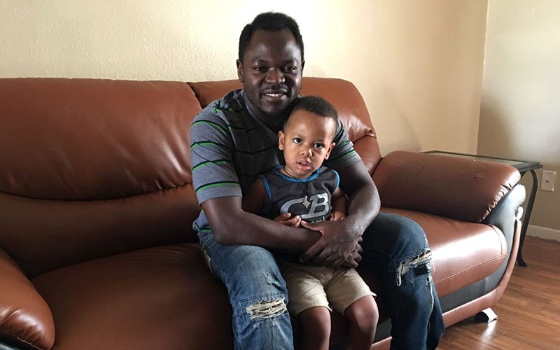 Timothy Zambakari, one of East Africa's most famous musicians, fled war-torn Sudan and settled in Phoenix, where he is raising his two sons, Romeo (2, seen here) and Aaron (1). (Photo by Mindy Riesenberg/Cronkite News)