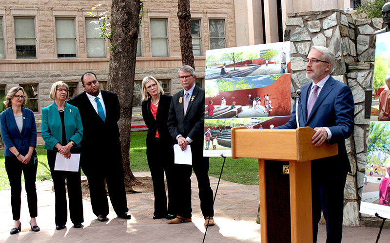 Congressman Randall Friese (D-9) addresses the press February 22, 2017 in Phoenix, Arizona on the status of the House Bill 2436 which would help fund a memorial for the Tuscon shooting in 2011. Next to him, from left to right are Representative Kirsten Engel (D-10), Pam Simon, Representative Daniel Hernandez (D-2), Crystal Kasnoff, and Todd Clodfelter (R-10). (Photo by Devon Cordell/ Cronkite News)