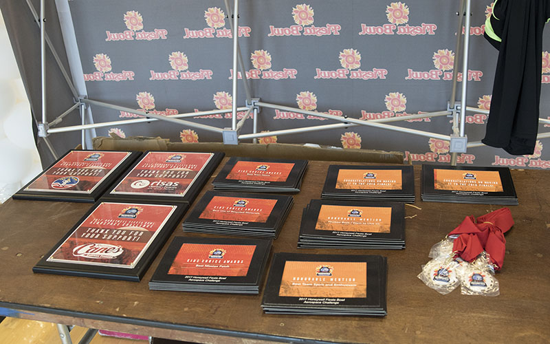 A look at some of the medals and awards that students can win while competing in the Honeywell Fiesta Bowl Aerospace Challenge. (Photo by Josh Orcutt/Cronkite News)