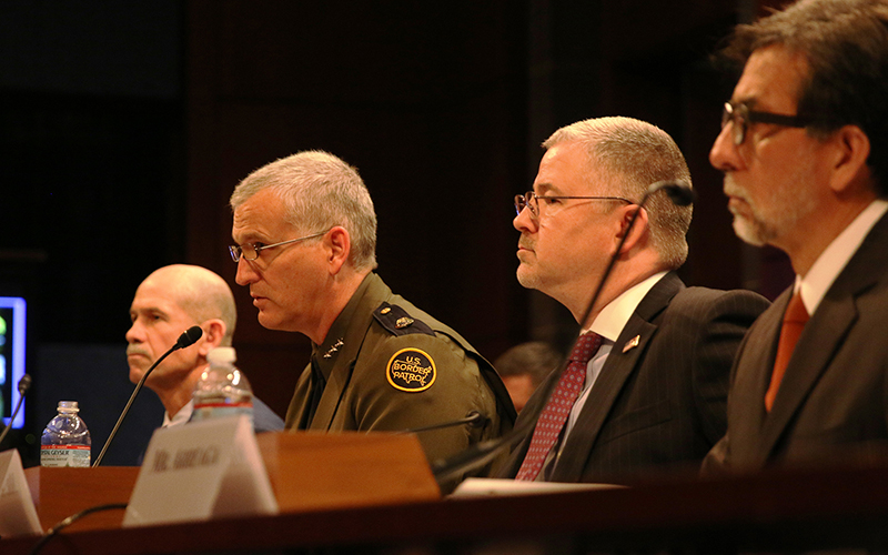 """Border Patrol's Paul Beeson, center, chief of a joint task force in Arizona, with other law enforcement officails testifying to a House subcommittee on the threat posed by """"sophisticated"""" drug cartels. (Photo by Andres Guerra Luz/Cronkite News)"""