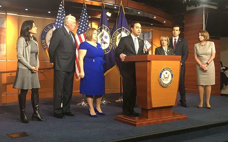 Rep. Joaquin Castro, D-Texas, flanked by fellow Democrats, speaks after a closed-door meeting with ICE Acting Director Thomas Homan on recent actions that ICE said is business as usual, but critics fear is a return to immigration raids. (Photo by Joseph Guzman/Cronkite News)