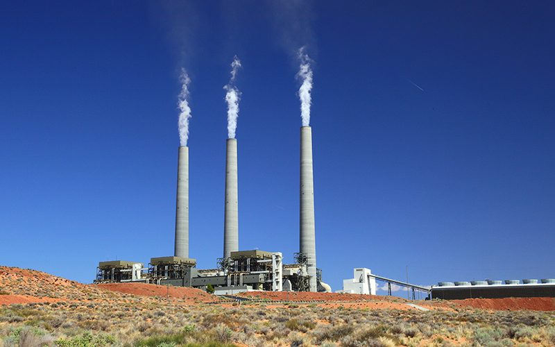 "The Navajo Generating Station near Page burns locally mined coal to generate power for the Central Arizona Project, among other clients. Environmental groups have long criticized the plant for the level of pollutants it emits. (a href=""https://flic.kr/p/ap1SZp"" target=""_blank"">Photo by Bill Morrow/Creative Commons)"