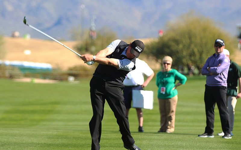 PGA pro Phil Mickelson hits his approach shot during the celebrity pro-am at the Waste Management Phoenix Open. (Photo by Tyler Drake/ Cronkite News)