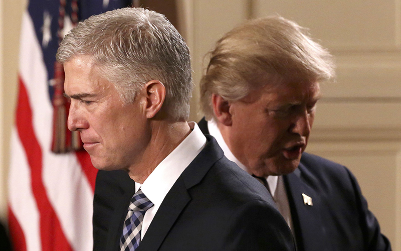 President Donald Trump introduces Circuit Judge Neil Gorsuch, left, whom he has nominated to a vacant seat on the Supreme Court. Trump had promised during teh campaign to name a judge in line with the conservative approach of the late Justice Antonin Scalia. (Photo by Carlos Barria/Reuters)