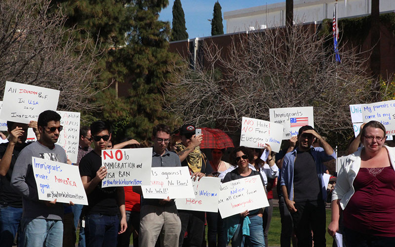 Students and scholars from the seven countries affected by President Trump's travel ban were joined by their peers for a solidarity rally on ASU's Hayden Lawn in Tempe, Arizona, where they displayed signs with messages on the immigration and refugee ban. (Photo by Rachael Bouley/Cronkite News)