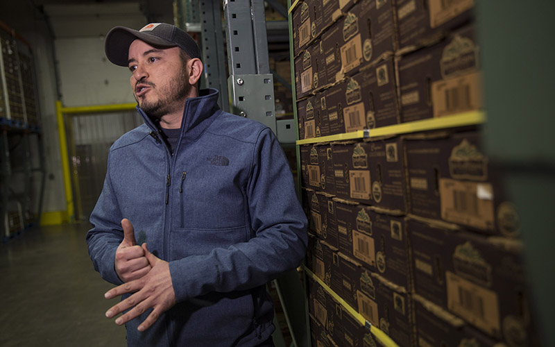 Juan Pablo Grijalva, a supervisor at the Wholesum Famly Farms distribution center in Nogales, Arizona is worried a proposed 20% tax on goods from Mexico will lead the produce company to layoff workers. (Photo by Jojo Huckeba/Cronkite News)