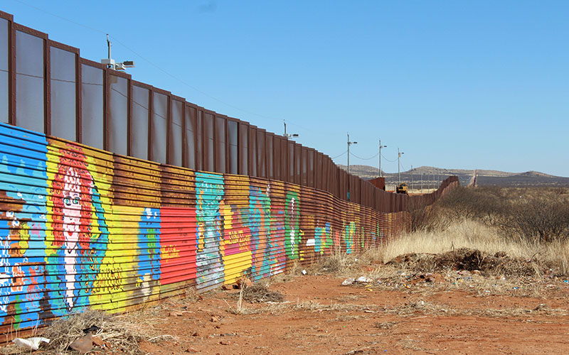 For six years children in Naco, Mexico, painted a mural on a border fence. On Tuesday demolition began on the fence - and the mural. (Photo by Charlene Santiago/Cronkite News)