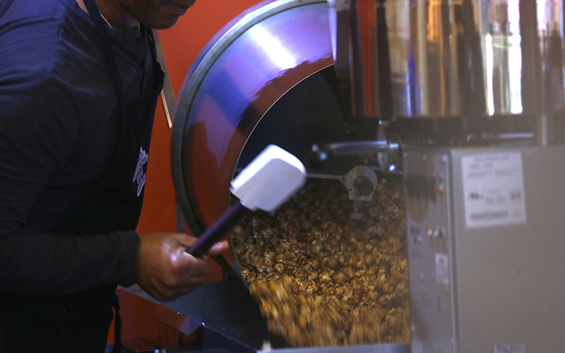 Nizar Olabi, co-owner of Flagstaff Nut House, said the minimum-wage increase will force his business to increase prices on popcorn and other sweet treats. (Photo by Jessica Clark/ Cronkite News).