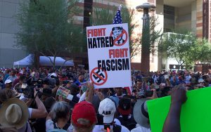 Fight Hatred Sign in Crowd