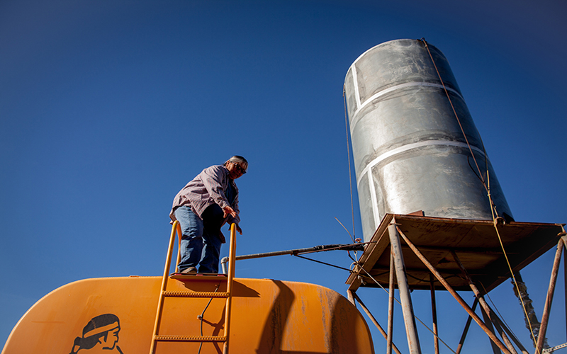Man on top of water tank