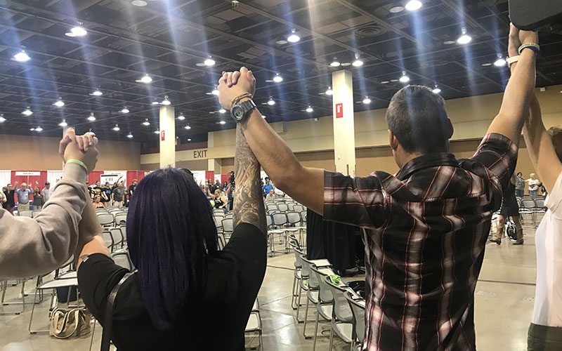 People hold hands in solidarity