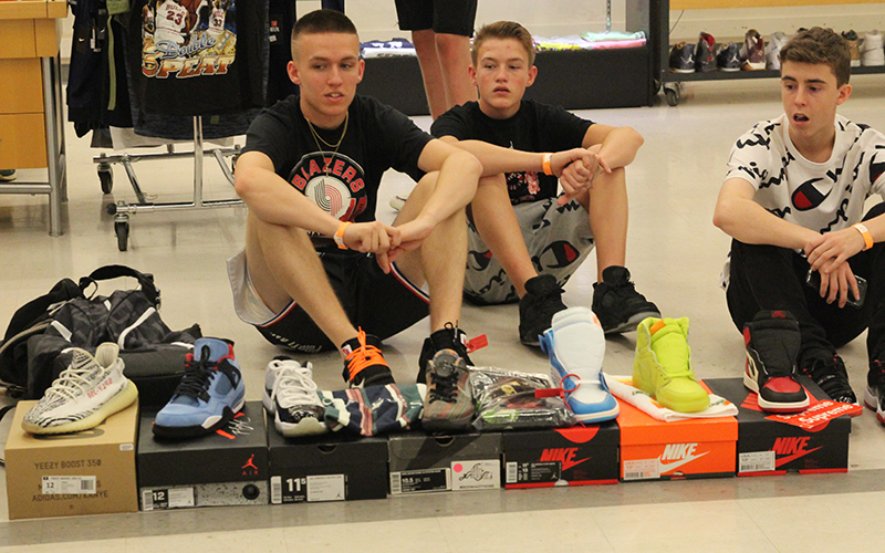 Kyle Warner (left) and his friends set up their own station of shoes that  they were trying to sell. It wasn t the biggest display at the Heated Sole  Summit 137aac341