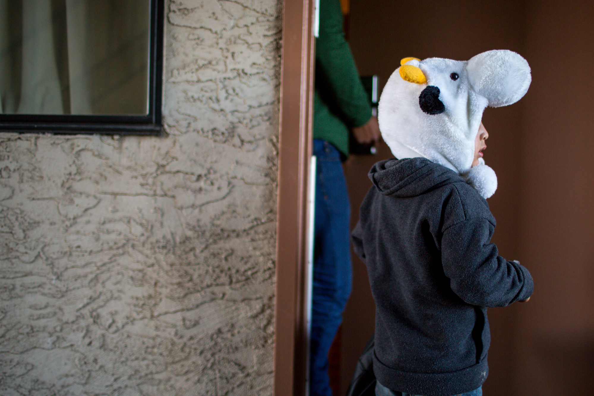 The migrants who traveled from Central America turned the motel into a  temporary neighborhood where children chased one another under stairwells.