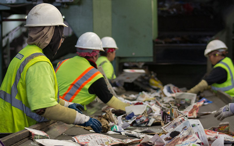 Workers sort through recycled material at a facility in Phoenix.