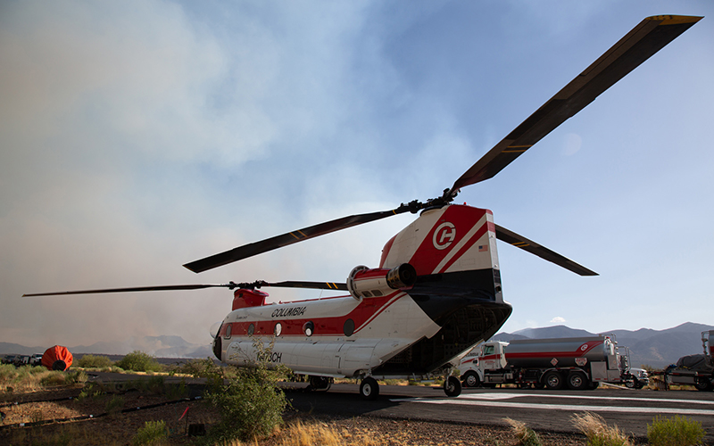 A Type 1 Colombia CH47D helicopter, which carries a water bucket that holds up to 2,800 gallons, is refueled and ready to be redeployed to the Woodbury Fire. Photo taken on June 22, 2019 by Anton L. Delgado/News21.