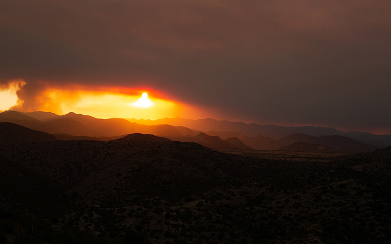 Smoke from the 124,000-acre Woodbury Fire northwest of Superior – the fifth largest wildfire in state history – made for picturesque sunsets across Arizona. (Photo by Anton L. Delgado/News21)