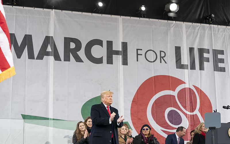 Trump vies for votes at massive anti-abortion rally
