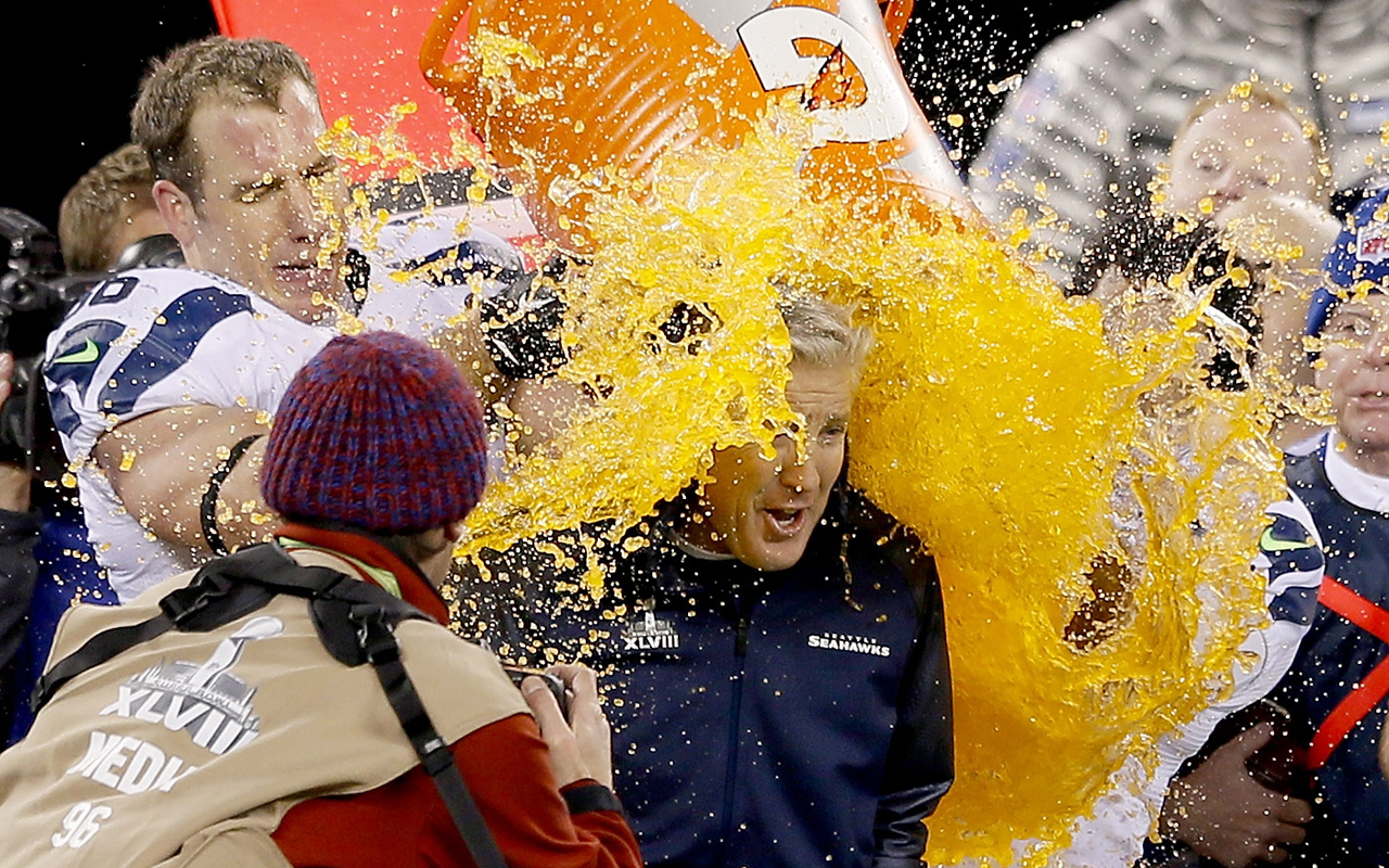 Zach Miller gives coach Pete Carroll a celebratory Gatorade shower after thrashing the Peyton Manning-led Denver Broncos in Super Bowl XLVIII. Miller said it's difficult to describe the feeling of winning a championship at the highest level. (Photo by Jeff Gross/Getty Images)