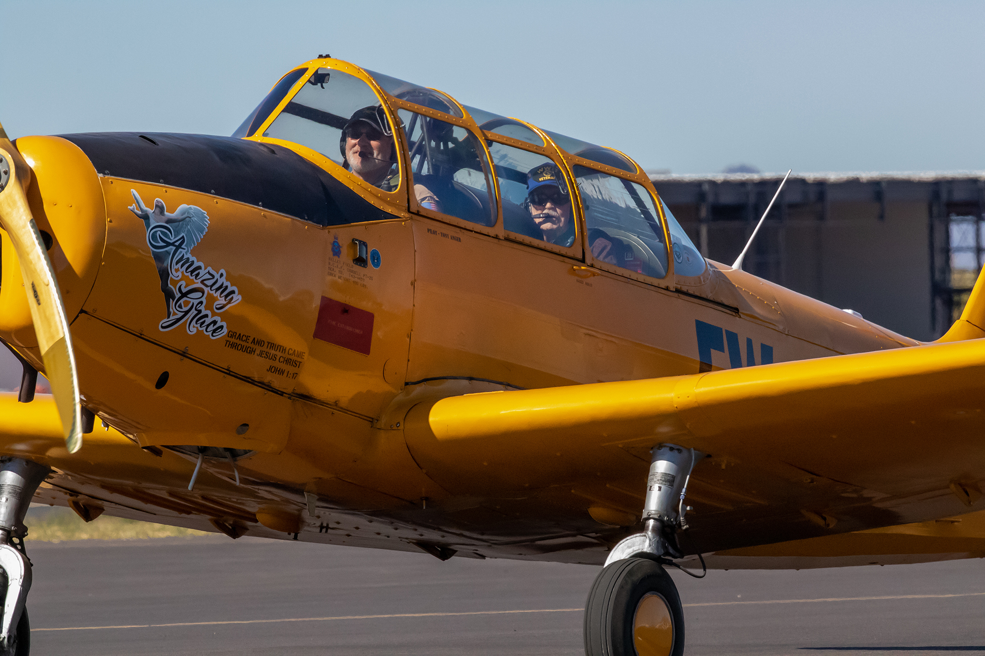 Tony Anger and Norman Langeliers land Amazing Grace, Anger's 77-year-old Fairchild PT-26 trainer, at Mesa's Falcon Field Airport on Feb. 21. (Photo by Rachel Stapholz/Cronkite News)