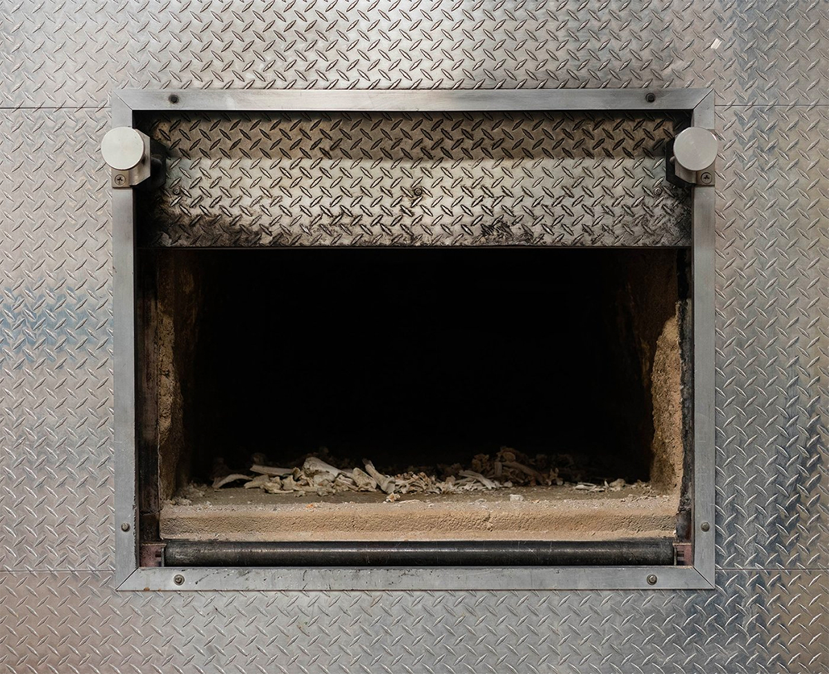 Cremated remains lie in the incineration chamber at the Paradise Memorial Crematory in Scottsdale, one of the state's largest. Partly fueled by the pandemic, the U.S. cremation rate reached 56% in 2020; it was 67% in Arizona. (Photo by Kevin Pirehpour/Cronkite News)