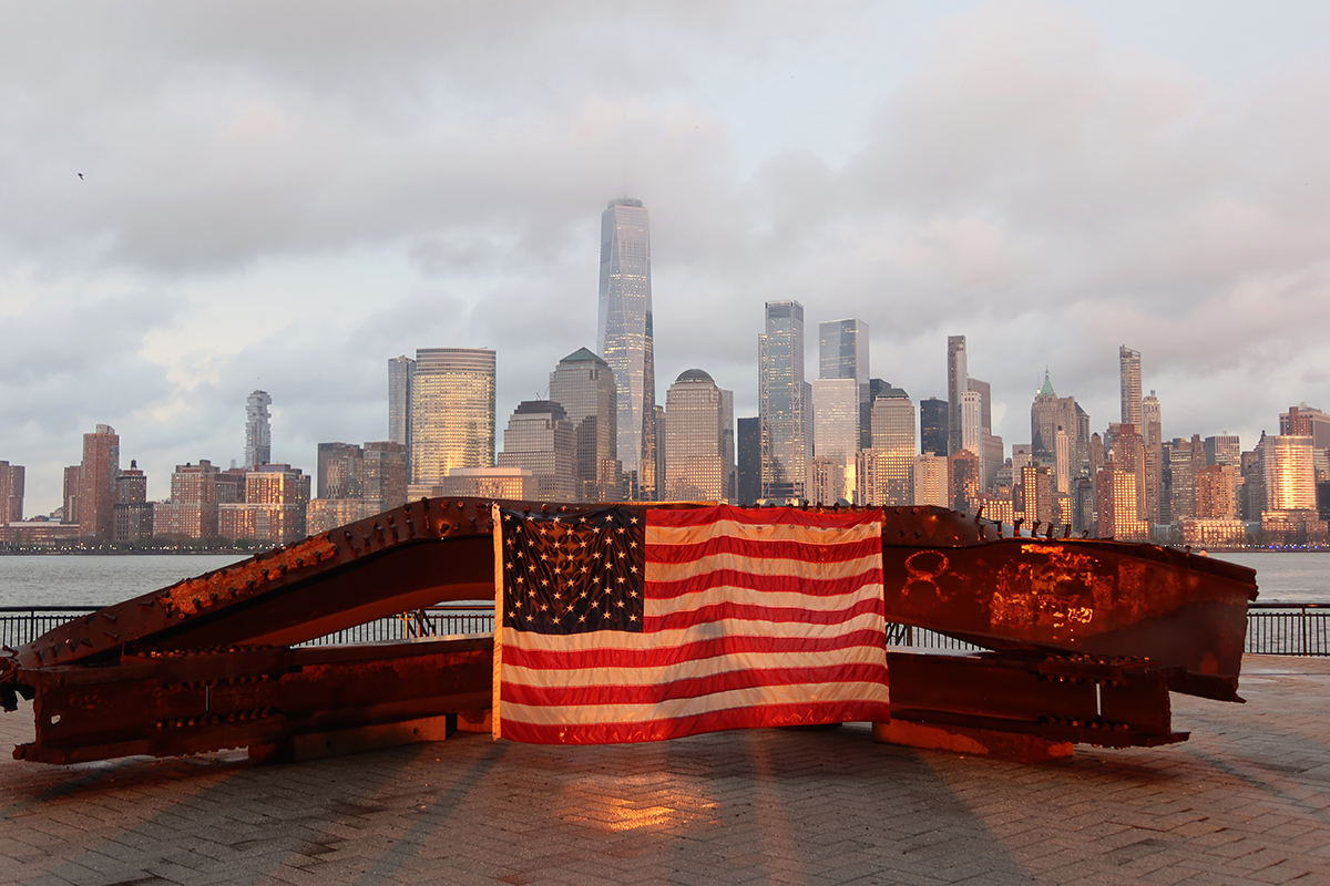"""Among the many whose lives were affected by the Sept. 11 terrorist attacks were a prominent football coach, player and sports journalist. """"All of a sudden, I see towers. I see a plane on the news running into the tower,"""" then-Jets coach Herm Edwards said. (Photo by Gary Hershorn/Getty Images)"""
